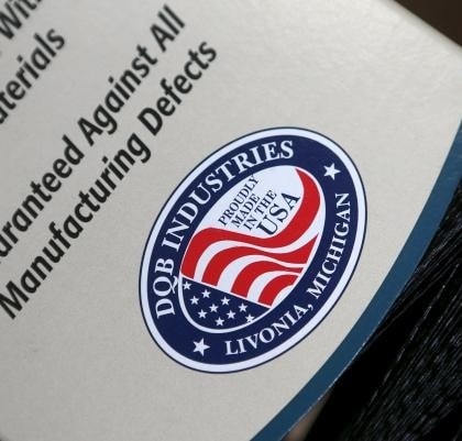 A 'Proudly made in the USA' logo is seen on the packaging of a brush produced at Detroit Quality Brushes in Livonia, Michigan July 10, 2015. Photo Credit: REUTERS/Rebecca Cook