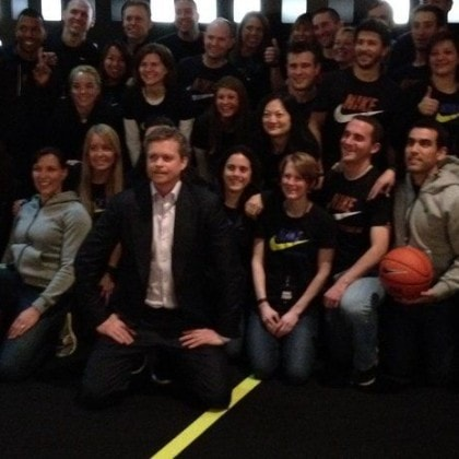 Nike chief executive Mark Parker, front and center, poses with Nike employees following the introduction of several new Nike products at a media event in February 2012 in New York City. (Allan Brettman photo)