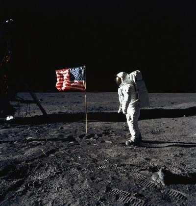 U.S. Astronaut Edwin E. Aldrin, Jr., lunar module pilot of the first lunar landing mission, poses for a photograph beside the deployed United States flag during Apollo 11.  |  Photo Credit: NASA/AFP/GETTY IMAGES