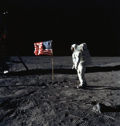 Man on the moon - U.S. Astronaut Edwin E. Aldrin, Jr., lunar module pilot of the first lunar landing mission, poses for a photograph beside the deployed United States flag during Apollo 11.
