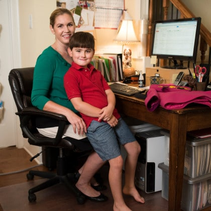 Molly Goodall with her son, Carter, whose refusal to wear hoods on his jackets inspired her to begin designing coats to sell on Etsy. | Photo Credit:  Cooper Neill for The New York Times