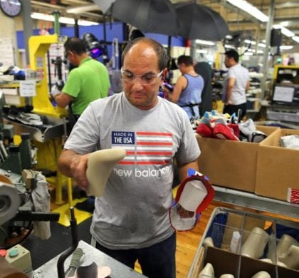 JOHN TLUMACKI/GLOBE STAFF/FILE 2015  At the New Balance factory in Lawrence, Isali Ruiz formed running shoes on a mold.